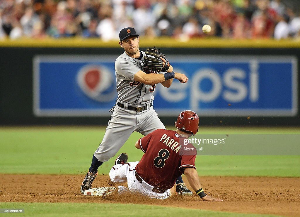 <a gi-track='captionPersonalityLinkClicked' href=/galleries/search?phrase=Ian+Kinsler&family=editorial&specificpeople=538104 ng-click='$event.stopPropagation()'>Ian Kinsler</a> #3 of the Detroit Tigers turns a double play as <a gi-track='captionPersonalityLinkClicked' href=/galleries/search?phrase=Gerardo+Parra&family=editorial&specificpeople=4959447 ng-click='$event.stopPropagation()'>Gerardo Parra</a> #8 of the Arizona Diamondbacks slides into second base during the second inning at Chase Field on July 23, 2014 in Phoenix, Arizona.