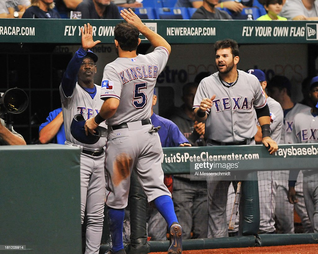 <a gi-track='captionPersonalityLinkClicked' href=/galleries/search?phrase=Ian+Kinsler&family=editorial&specificpeople=538104 ng-click='$event.stopPropagation()'>Ian Kinsler</a> #5 of the Texas Rangers celebrates after scoing in the fourth inning against the Tampa Bay Rays September 19, 2013 at Tropicana Field in St. Petersburg, Florida. Texas won 8 - 2.