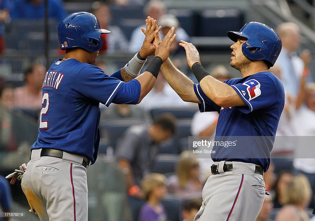 <a gi-track='captionPersonalityLinkClicked' href=/galleries/search?phrase=Ian+Kinsler&family=editorial&specificpeople=538104 ng-click='$event.stopPropagation()'>Ian Kinsler</a> #5 of the Texas Rangers celebrates with teammte Leonys Martin #2 after scoring on Adrian Beltre #29 two run double in the third inningat Yankee Stadium on June 26, 2013 in the Bronx borough of New York City.