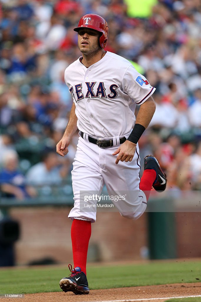 Ian Kinsler #5 of the Texas Rangers crosses home plate for the first run of the game against the New York Yankees on July 24, 2013 at the Rangers Ballpark in Arlington in Arlington, Texas.