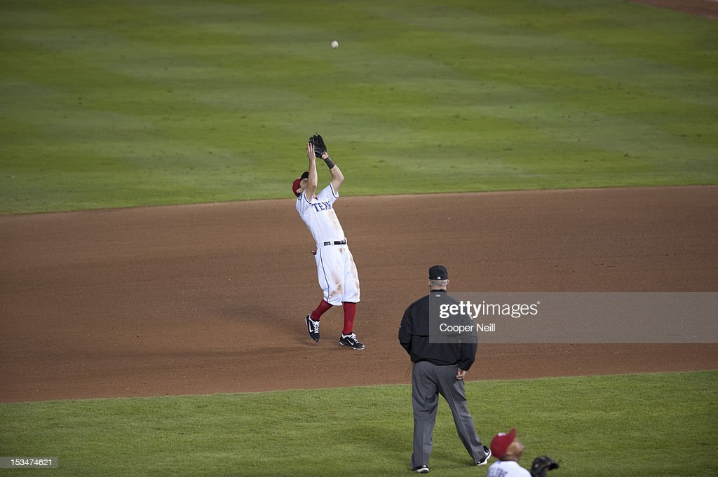 <a gi-track='captionPersonalityLinkClicked' href=/galleries/search?phrase=Ian+Kinsler&family=editorial&specificpeople=538104 ng-click='$event.stopPropagation()'>Ian Kinsler</a> #5 of the Texas Rangers fields a fly ball during the American League Wild Card game against the Baltimore Orioles on October 5, 2012 at the Rangers Ballpark in Arlington in Arlington, Texas.