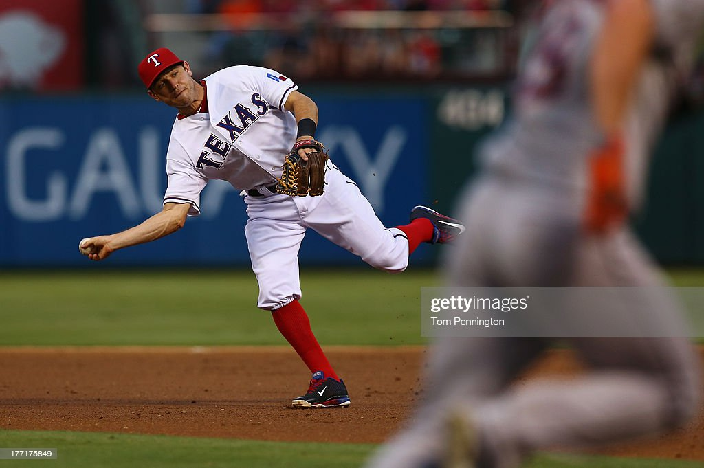 <a gi-track='captionPersonalityLinkClicked' href=/galleries/search?phrase=Ian+Kinsler&family=editorial&specificpeople=538104 ng-click='$event.stopPropagation()'>Ian Kinsler</a> #5 of the Texas Rangers fields a ground ball, hit by Robbie Grossman #19 of the Houston Astros, for the out in the top of the third inning at Rangers Ballpark in Arlington on August 21, 2013 in Arlington, Texas.