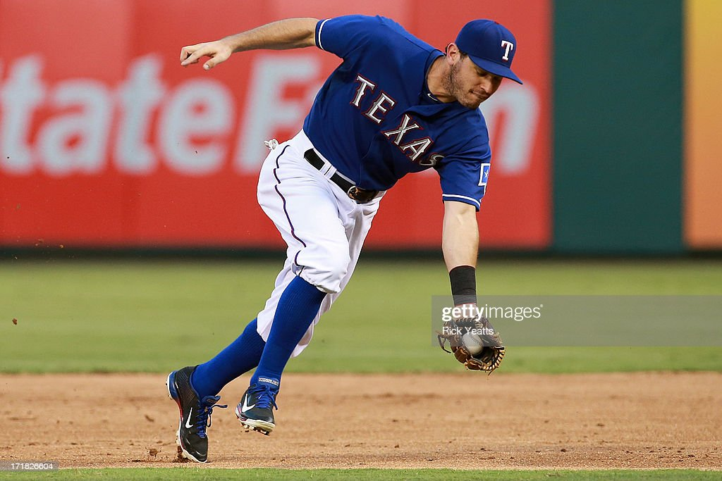 <a gi-track='captionPersonalityLinkClicked' href=/galleries/search?phrase=Ian+Kinsler&family=editorial&specificpeople=538104 ng-click='$event.stopPropagation()'>Ian Kinsler</a> #5 of the Texas Rangers fields a ground ball throwing to first base for the out against the Cincinnati Reds at Rangers Ballpark in Arlington on June 28, 2013 in Arlington, Texas.