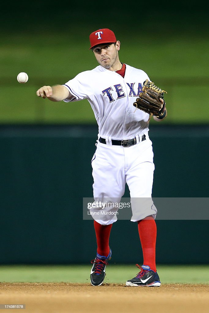 Ian Kinsler #5 of the Texas Rangers fields the ball against the New York Yankees on July 24, 2013 at the Rangers Ballpark in Arlington in Arlington, Texas.