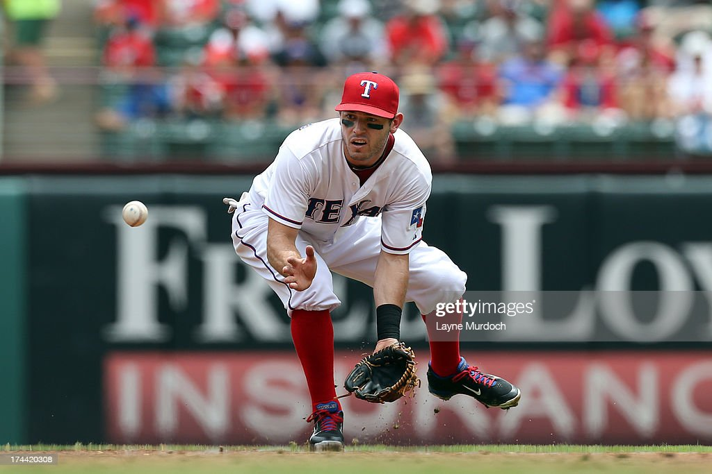 <a gi-track='captionPersonalityLinkClicked' href=/galleries/search?phrase=Ian+Kinsler&family=editorial&specificpeople=538104 ng-click='$event.stopPropagation()'>Ian Kinsler</a> #5 of the Texas Rangers fields the hit and throws out Lyle Overby of the New York Yankees on July 25, 2013 at the Rangers Ballpark in Arlington in Arlington, Texas.