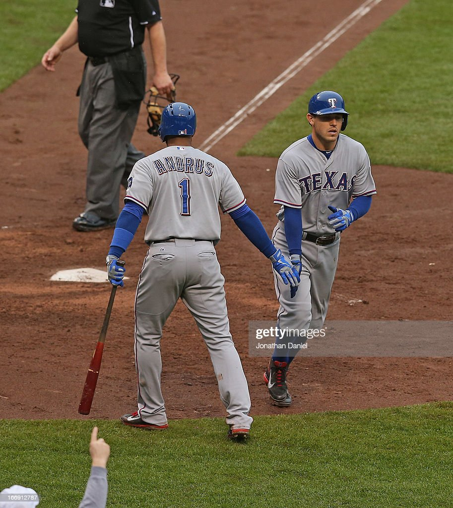 <a gi-track='captionPersonalityLinkClicked' href=/galleries/search?phrase=Ian+Kinsler&family=editorial&specificpeople=538104 ng-click='$event.stopPropagation()'>Ian Kinsler</a> #5 of the Texas Rangers is congratulated by <a gi-track='captionPersonalityLinkClicked' href=/galleries/search?phrase=Elvis+Andrus&family=editorial&specificpeople=4845974 ng-click='$event.stopPropagation()'>Elvis Andrus</a> #1 after hitting a solo home run in the 4th inning against the Chicago Cubs at Wrigley Field on April 18, 2013 in Chicago, Illinois.