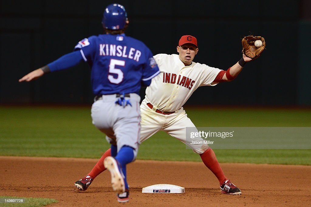 <a gi-track='captionPersonalityLinkClicked' href=/galleries/search?phrase=Ian+Kinsler&family=editorial&specificpeople=538104 ng-click='$event.stopPropagation()'>Ian Kinsler</a> #5 of the Texas Rangers is out at second after an attempted steal as shortstop Asdrubal Cabrera #13 of the Cleveland Indians makes the catch during the seventh inning at Progressive Field on May 5, 2012 in Cleveland, Ohio.