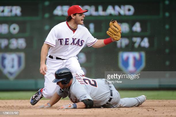 Ian Kinsler of the Texas Rangers reacts as Jhonny Peralta of the Detroit Tigers slides in safe at second base on a double in the third inning of Game...