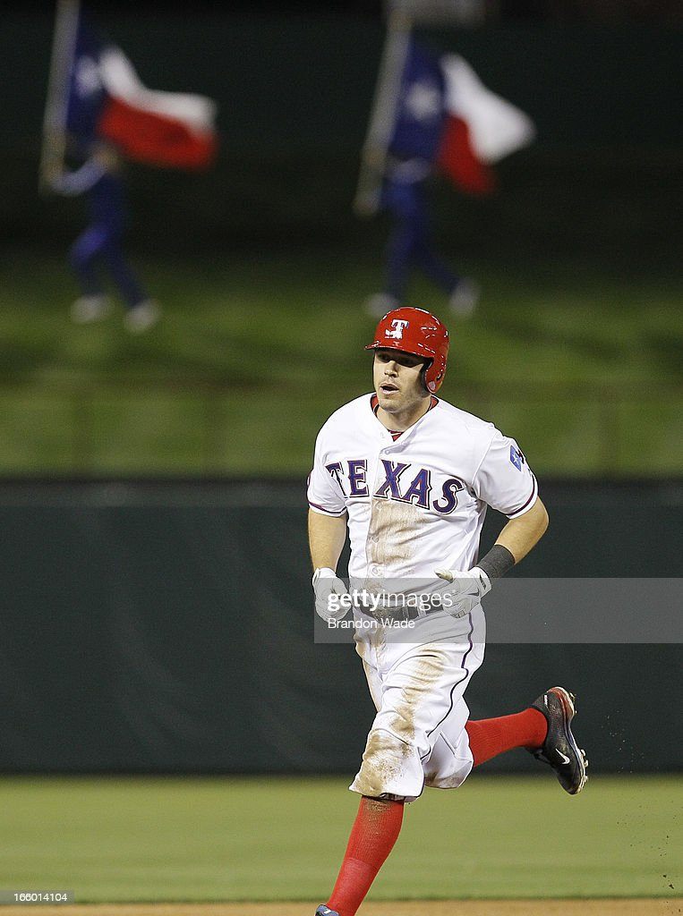 <a gi-track='captionPersonalityLinkClicked' href=/galleries/search?phrase=Ian+Kinsler&family=editorial&specificpeople=538104 ng-click='$event.stopPropagation()'>Ian Kinsler</a> #5 of the Texas Rangers rounds the bases after hitting a three-run home run in the sixth inning of a baseball game against the Los Angeles Angels of Anaheim at Rangers Ballpark in Arlington on April 7, 2013 in Arlington, Texas.
