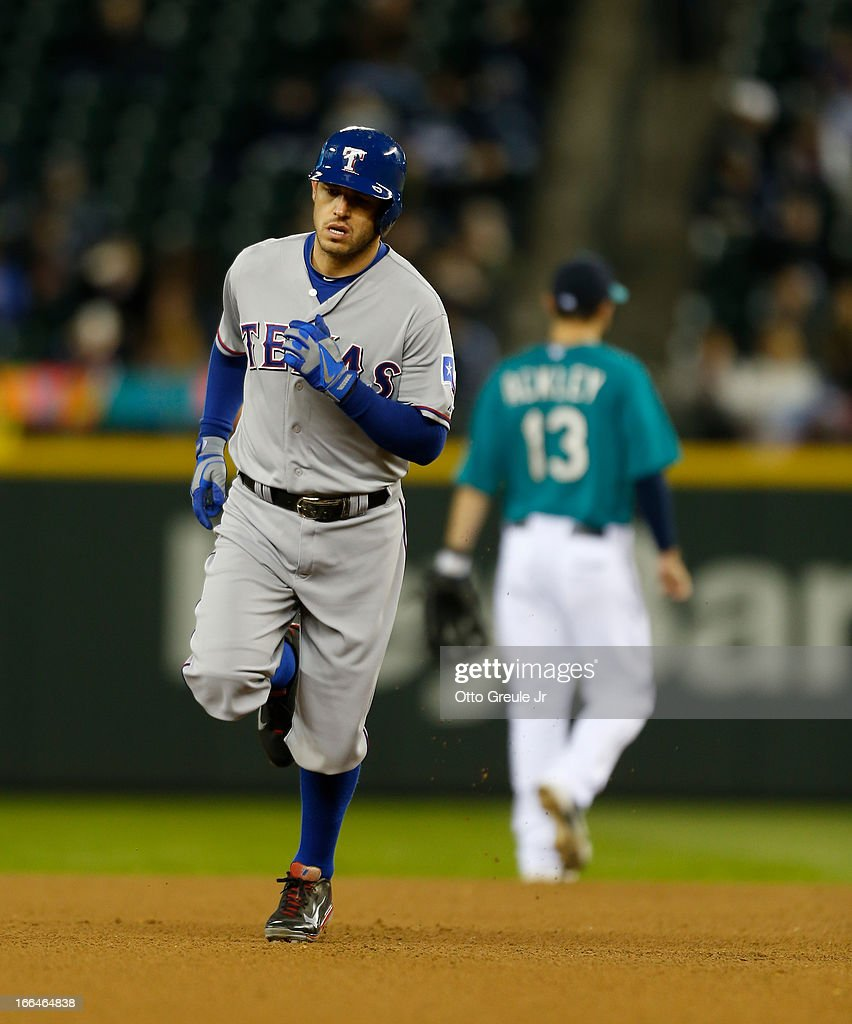 <a gi-track='captionPersonalityLinkClicked' href=/galleries/search?phrase=Ian+Kinsler&family=editorial&specificpeople=538104 ng-click='$event.stopPropagation()'>Ian Kinsler</a> #5 of the Texas Rangers rounds the bases after hitting a solo home run in the fourth inning against the Seattle Mariners at Safeco Field on April 12, 2013 in Seattle, Washington.