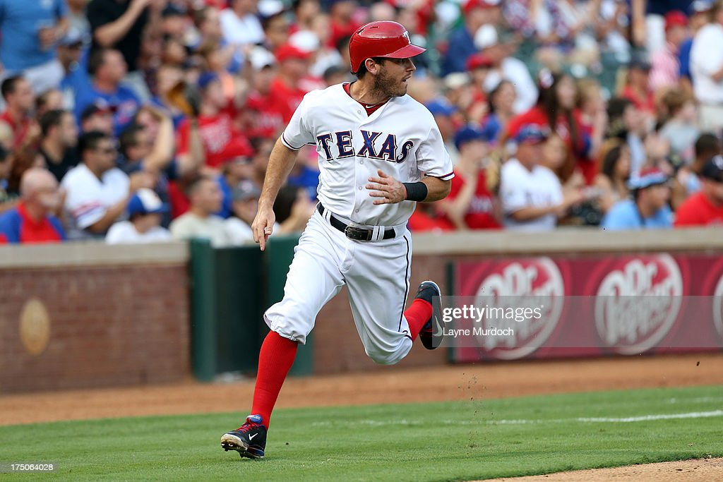 <a gi-track='captionPersonalityLinkClicked' href=/galleries/search?phrase=Ian+Kinsler&family=editorial&specificpeople=538104 ng-click='$event.stopPropagation()'>Ian Kinsler</a> #5 of the Texas Rangers scores against the Los Angeles Angels of Anaheim on July 30, 2013 at the Rangers Ballpark in Arlington in Arlington, Texas.