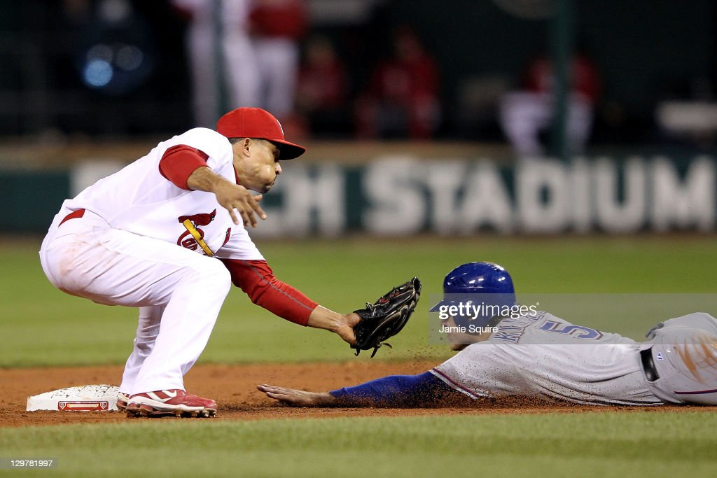 Ian Kinsler of the Texas Rangers steals second base ahead of the tag by Rafael Furcal of the St Louis Cardinals in the ninth inning during Game Two...
