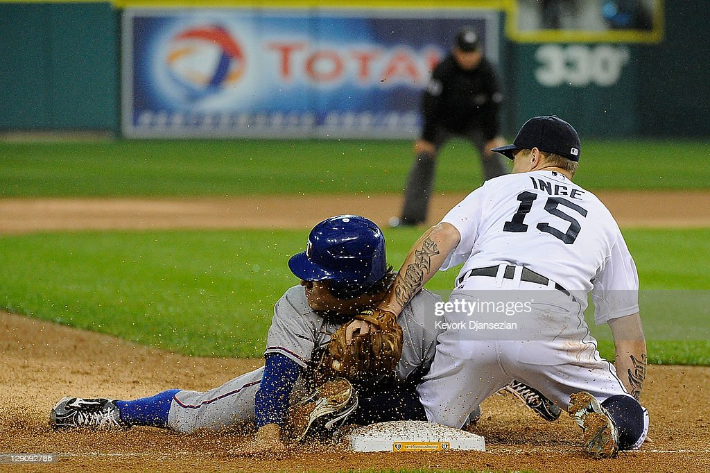Ian Kinsler of the Texas Rangers steals third base in the sixth inning of Game Four of the American League Championship Series against the Detroit...