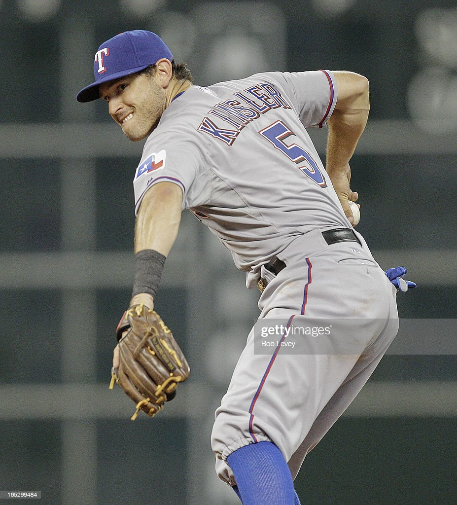 <a gi-track='captionPersonalityLinkClicked' href=/galleries/search?phrase=Ian+Kinsler&family=editorial&specificpeople=538104 ng-click='$event.stopPropagation()'>Ian Kinsler</a> #5 of the Texas Rangers throws to first base to retire Jason Castro #15 of the Houston Astros at Minute Maid Park on April 2, 2013 in Houston, Texas.