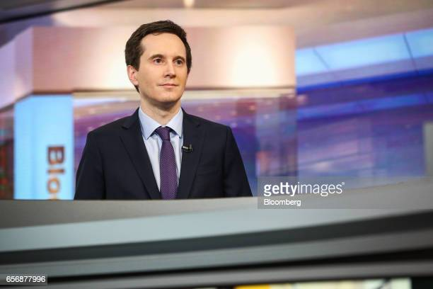 Ian Lyngen head of US rates strategy at BMO Capital Markets Corp listens during a Bloomberg Television interview in New York US on Thursday March 23...