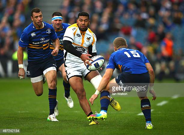 Ian Madigan of Leinster tries to tackle Charles Piutau of Wasps during the European Rugby Champions Cup match between Leinster Rugby and Wasps at the...