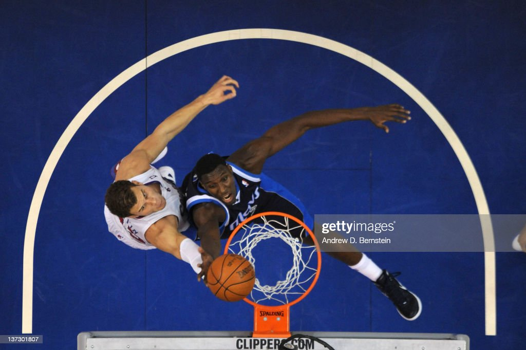 <a gi-track='captionPersonalityLinkClicked' href=/galleries/search?phrase=Ian+Mahinmi&family=editorial&specificpeople=740196 ng-click='$event.stopPropagation()'>Ian Mahinmi</a> #28 of the Dallas Mavericks goes up for a shot against <a gi-track='captionPersonalityLinkClicked' href=/galleries/search?phrase=Blake+Griffin+-+Basketball+Player&family=editorial&specificpeople=4216010 ng-click='$event.stopPropagation()'>Blake Griffin</a> #32 of the Los Angeles Clippers at Staples Center on January 18, 2012 in Los Angeles, California.