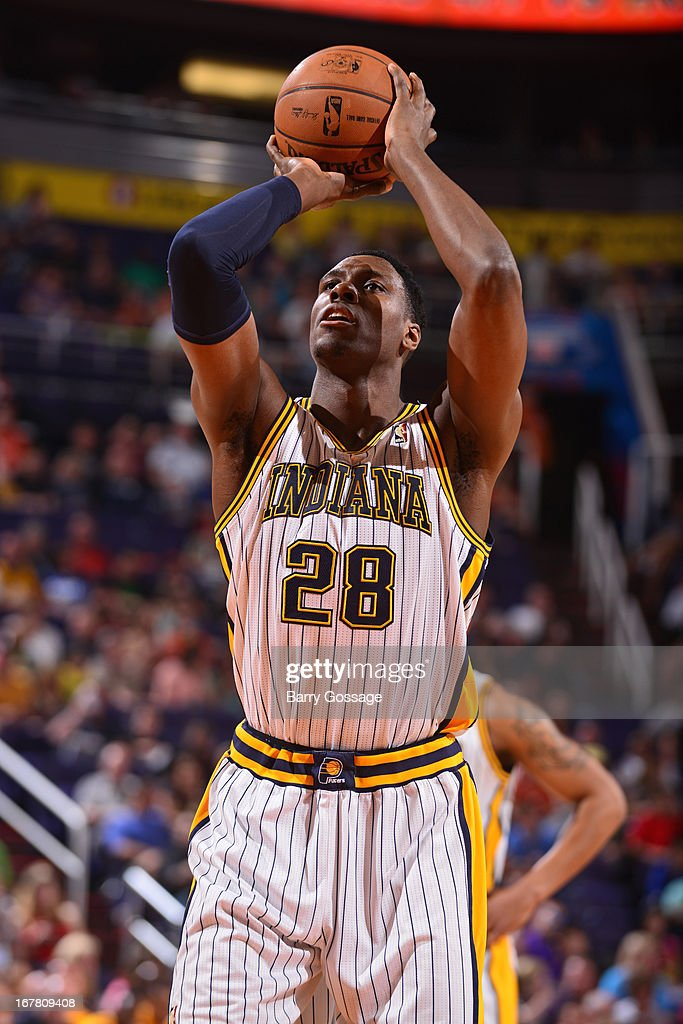 <a gi-track='captionPersonalityLinkClicked' href=/galleries/search?phrase=Ian+Mahinmi&family=editorial&specificpeople=740196 ng-click='$event.stopPropagation()'>Ian Mahinmi</a> #28 of the Indiana Pacers attempts a foul shot against the Phoenix Suns on March 30, 2013 at U.S. Airways Center in Phoenix, Arizona.