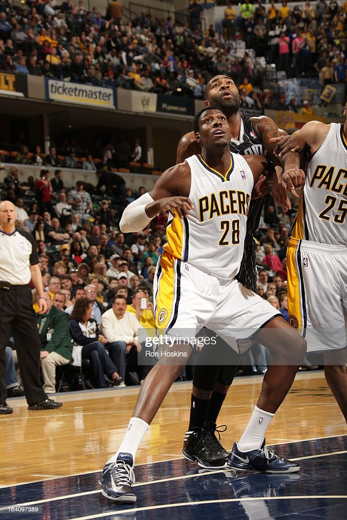 Ian Mahinmi #28 of the Indiana Pacers attempts to grab the rebound against the Orlando Magic on March 19, 2013 at Bankers Life Fieldhouse in Indianapolis, Indiana.