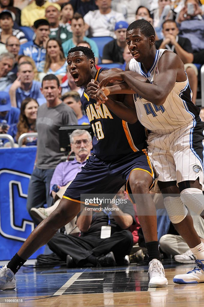 Ian Mahinmi #28 of the Indiana Pacers battles for position against Andrew Nicholson #44 of the Orlando Magic during the game on January 16, 2013 at Amway Center in Orlando, Florida.