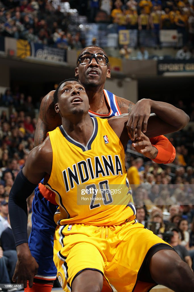 Ian Mahinmi #28 of the Indiana Pacers battles for positioning against Amar'e Stoudemire #1 of the New York Knicks on January 10, 2013 at Bankers Life Fieldhouse in Indianapolis, Indiana.
