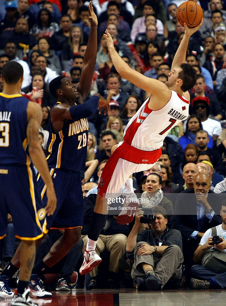 <a gi-track='captionPersonalityLinkClicked' href=/galleries/search?phrase=Ian+Mahinmi&family=editorial&specificpeople=740196 ng-click='$event.stopPropagation()'>Ian Mahinmi</a> #28 of the Indiana Pacers blocks a shot from <a gi-track='captionPersonalityLinkClicked' href=/galleries/search?phrase=Andrea+Bargnani&family=editorial&specificpeople=533014 ng-click='$event.stopPropagation()'>Andrea Bargnani</a> #7 of the Toronto Raptors on October 31, 2012 at the Air Canada Centre in Toronto, Canada.