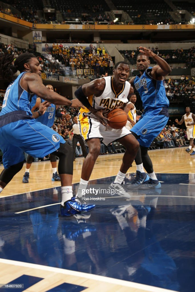 Ian Mahinmi #28 of the Indiana Pacers drives against Bernard James #5 of the Dallas Mavericks at Bankers Life Fieldhouse on October 16, 2013 in Indianapolis, Indiana.