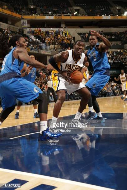 Ian Mahinmi of the Indiana Pacers drives against Bernard James of the Dallas Mavericks at Bankers Life Fieldhouse on October 16 2013 in Indianapolis...