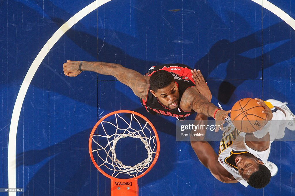 Ian Mahinmi #28 of the Indiana Pacers drives to the basket against Amir Johnson #15 of the Toronto Raptors on February 8, 2013 at Bankers Life Fieldhouse in Indianapolis, Indiana.