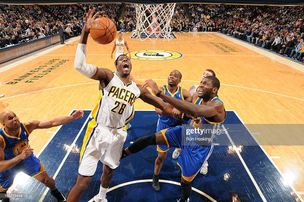 Ian Mahinmi #28 of the Indiana Pacers drives to the basket against the Golden State Warriors on February 26, 2013 at Bankers Life Fieldhouse in Indianapolis, Indiana.