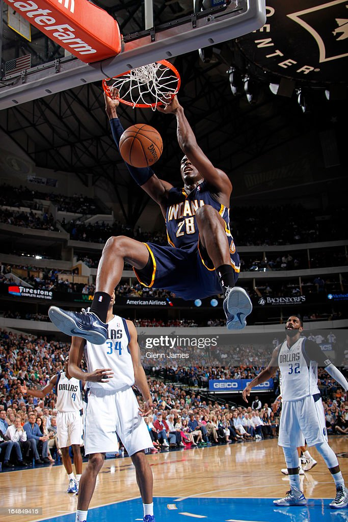 Ian Mahinmi #28 of the Indiana Pacers dunks against Brandan Wright #34 of the Dallas Mavericks on March 28, 2013 at the American Airlines Center in Dallas, Texas.