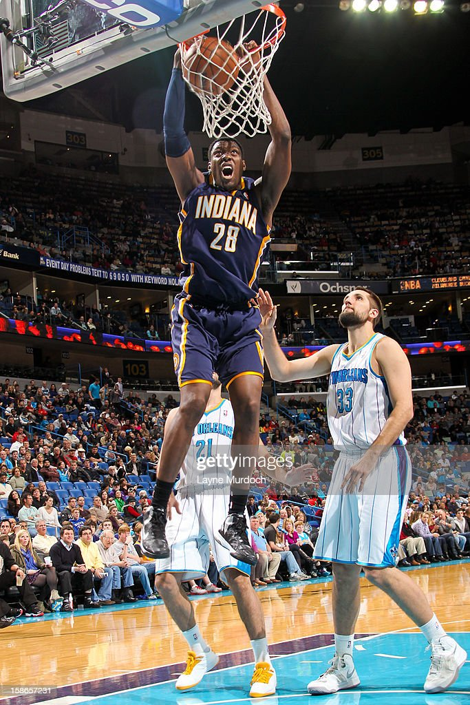 <a gi-track='captionPersonalityLinkClicked' href=/galleries/search?phrase=Ian+Mahinmi&family=editorial&specificpeople=740196 ng-click='$event.stopPropagation()'>Ian Mahinmi</a> #28 of the Indiana Pacers dunks against Ryan Anderson #33 of the New Orleans Hornets on December 22, 2012 at the New Orleans Arena in New Orleans, Louisiana.