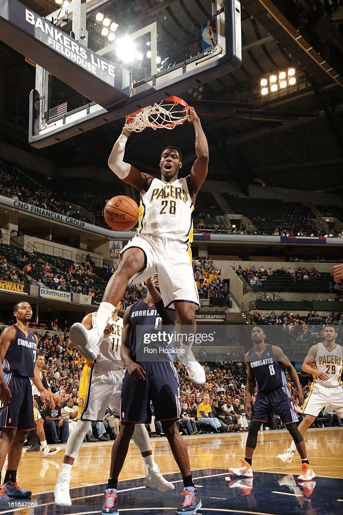 Ian Mahinmi #28 of the Indiana Pacers dunks against the Charlotte Bobcats on February 13, 2013 at Bankers Life Fieldhouse in Indianapolis, Indiana.