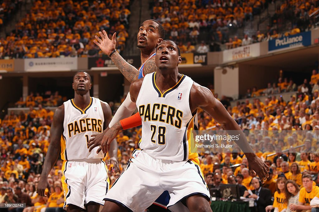 <a gi-track='captionPersonalityLinkClicked' href=/galleries/search?phrase=Ian+Mahinmi&family=editorial&specificpeople=740196 ng-click='$event.stopPropagation()'>Ian Mahinmi</a> #28 of the Indiana Pacers fights for position against <a gi-track='captionPersonalityLinkClicked' href=/galleries/search?phrase=J.R.+Smith&family=editorial&specificpeople=201766 ng-click='$event.stopPropagation()'>J.R. Smith</a> #8 of the New York Knicks in Game Six of the Eastern Conference Semifinals during the 2013 NBA Playoffs on May 18, 2013 at Bankers Life Fieldhouse in Indianapolis, Indiana.