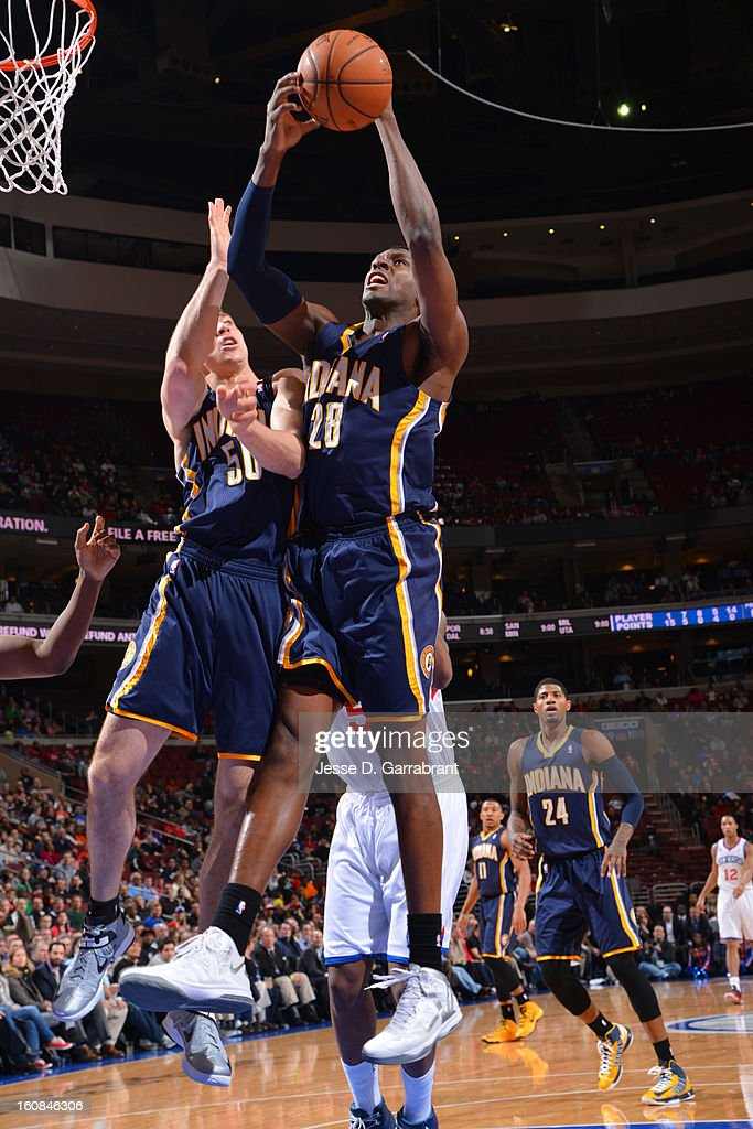 Ian Mahinmi #28 of the Indiana Pacers grabs a rebound against the Philadelphia 76ers during the game at the Wells Fargo Center on February 6, 2013 in Philadelphia, Pennsylvania.