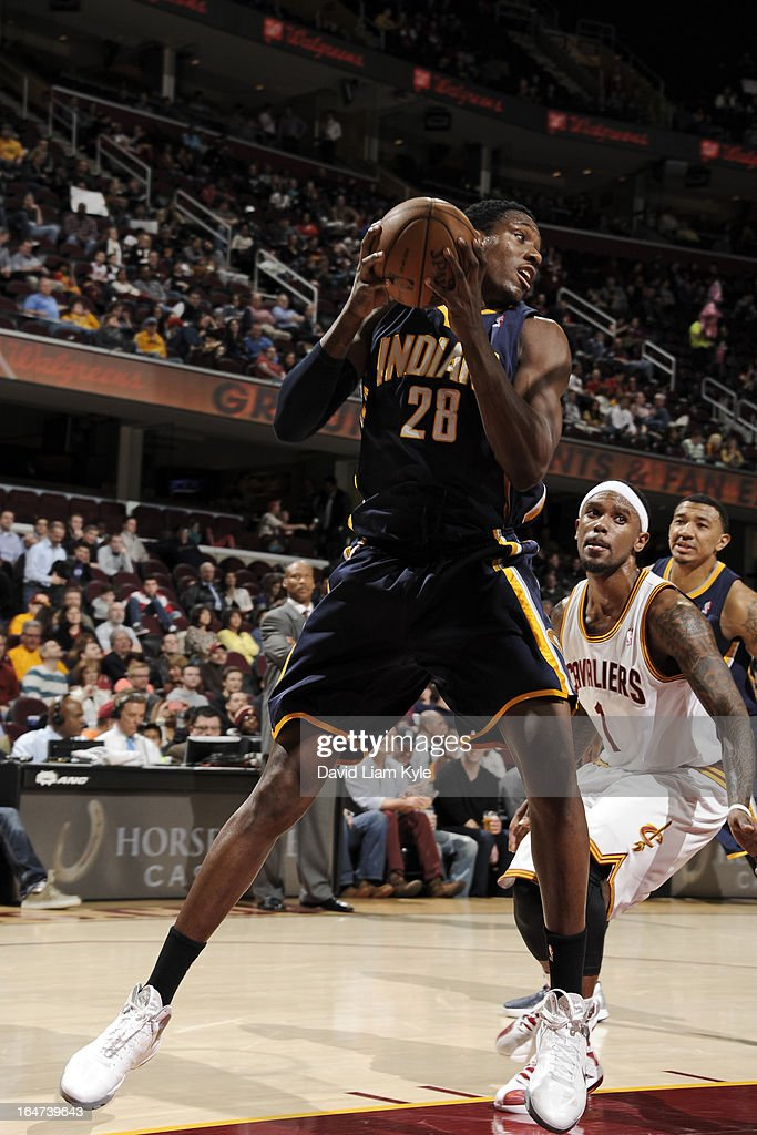 <a gi-track='captionPersonalityLinkClicked' href=/galleries/search?phrase=Ian+Mahinmi&family=editorial&specificpeople=740196 ng-click='$event.stopPropagation()'>Ian Mahinmi</a> #28 of the Indiana Pacers grabs a rebound against the Cleveland Cavaliers at The Quicken Loans Arena on March 18, 2013 in Cleveland, Ohio.