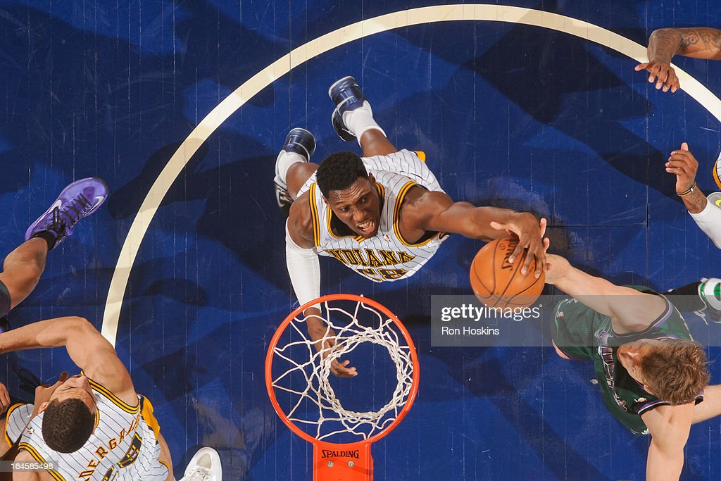 <a gi-track='captionPersonalityLinkClicked' href=/galleries/search?phrase=Ian+Mahinmi&family=editorial&specificpeople=740196 ng-click='$event.stopPropagation()'>Ian Mahinmi</a> #28 of the Indiana Pacers grabs a rebound against the Milwaukee Bucks on March 22, 2013 at Bankers Life Fieldhouse in Indianapolis, Indiana.