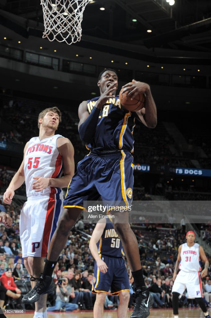 <a gi-track='captionPersonalityLinkClicked' href=/galleries/search?phrase=Ian+Mahinmi&family=editorial&specificpeople=740196 ng-click='$event.stopPropagation()'>Ian Mahinmi</a> #28 of the Indiana Pacers grabs a rebound against Viacheslav Kravtsov #55 of the Detroit Pistons on February 23, 2013 at The Palace of Auburn Hills in Auburn Hills, Michigan.