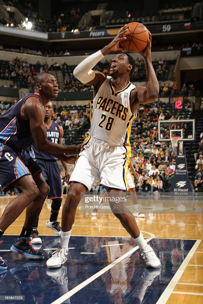 Ian Mahinmi #28 of the Indiana Pacers looks to go to the basket against Bismack Biyombo #0 of the Charlotte Bobcats on February 13, 2013 at Bankers Life Fieldhouse in Indianapolis, Indiana.