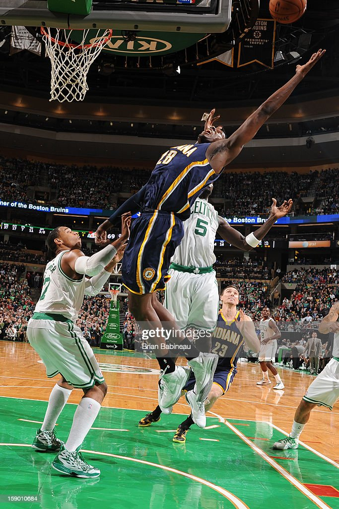 Ian Mahinmi #28 of the Indiana Pacers rebounds against Jared Sullinger #7 and Kevin Garnett #5 on January 4, 2013 at the TD Garden in Boston, Massachusetts.