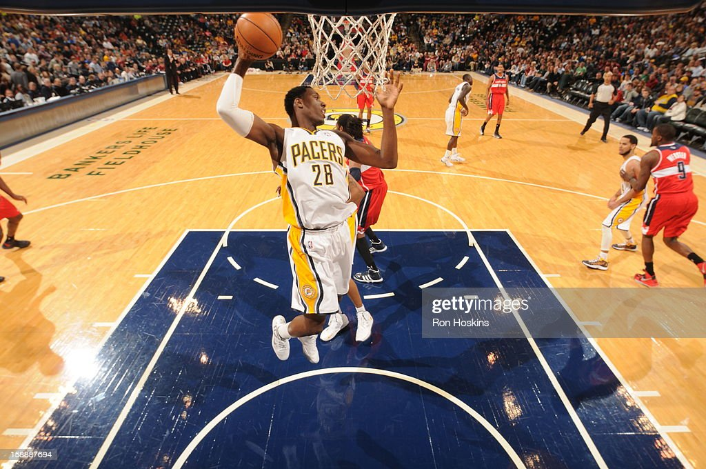 <a gi-track='captionPersonalityLinkClicked' href=/galleries/search?phrase=Ian+Mahinmi&family=editorial&specificpeople=740196 ng-click='$event.stopPropagation()'>Ian Mahinmi</a> #28 of the Indiana Pacers rebounds against the Washington Wizards on January 2, 2013 at Bankers Life Fieldhouse in Indianapolis, Indiana.