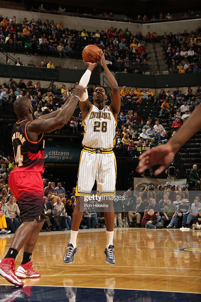 Ian Mahinmi #28 of the Indiana Pacers shoots against Ivan Johnson #44 of the Atlanta Hawks on March 25, 2013 at Bankers Life Fieldhouse in Indianapolis, Indiana.