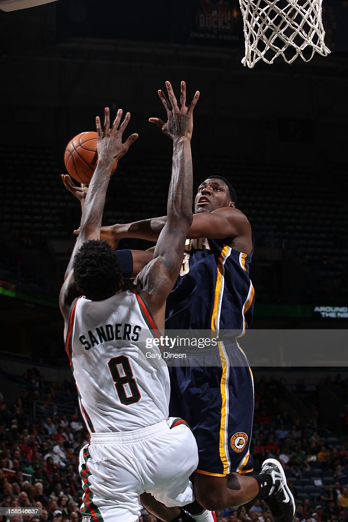 <a gi-track='captionPersonalityLinkClicked' href=/galleries/search?phrase=Ian+Mahinmi&family=editorial&specificpeople=740196 ng-click='$event.stopPropagation()'>Ian Mahinmi</a> #28 of the Indiana Pacers shoots against Larry Sanders #8 of the Milwaukee Bucks during the game on December 18, 2012 at the BMO Harris Bradley Center in Milwaukee, Wisconsin.
