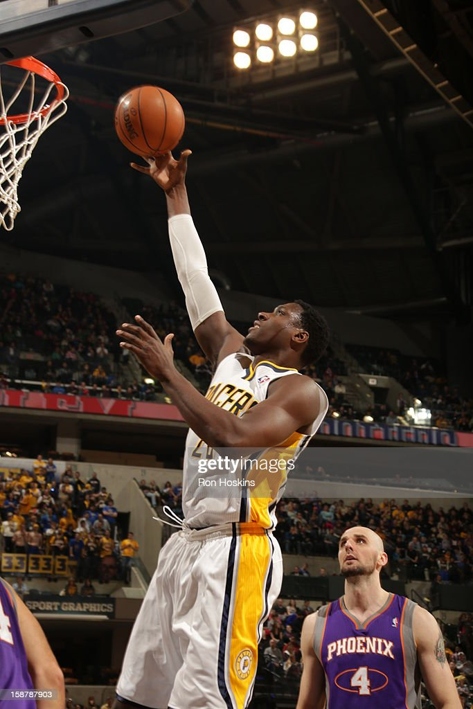 <a gi-track='captionPersonalityLinkClicked' href=/galleries/search?phrase=Ian+Mahinmi&family=editorial&specificpeople=740196 ng-click='$event.stopPropagation()'>Ian Mahinmi</a> #28 of the Indiana Pacers shoots against the Phoenix Suns the Phoenix Suns on December 28, 2012 at Bankers Life Fieldhouse in Indianapolis, Indiana.