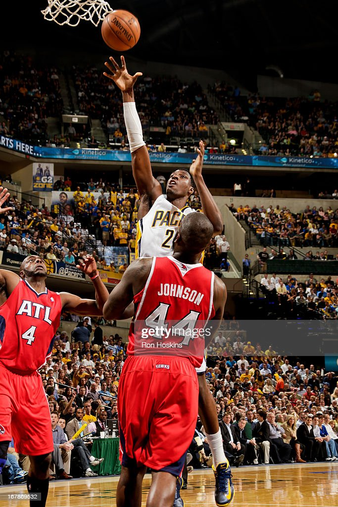 Ian Mahinmi #28 of the Indiana Pacers shoots in the lane against Ivan Johnson #44 of the Atlanta Hawks in Game Five of the Eastern Conference Quarterfinals during the 2013 NBA Playoffs on May 1, 2013 at Bankers Life Fieldhouse in Indianapolis, Indiana.