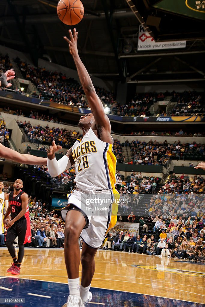 <a gi-track='captionPersonalityLinkClicked' href=/galleries/search?phrase=Ian+Mahinmi&family=editorial&specificpeople=740196 ng-click='$event.stopPropagation()'>Ian Mahinmi</a> #28 of the Indiana Pacers shoots in the lane against the Toronto Raptors on February 8, 2013 at Bankers Life Fieldhouse in Indianapolis, Indiana.
