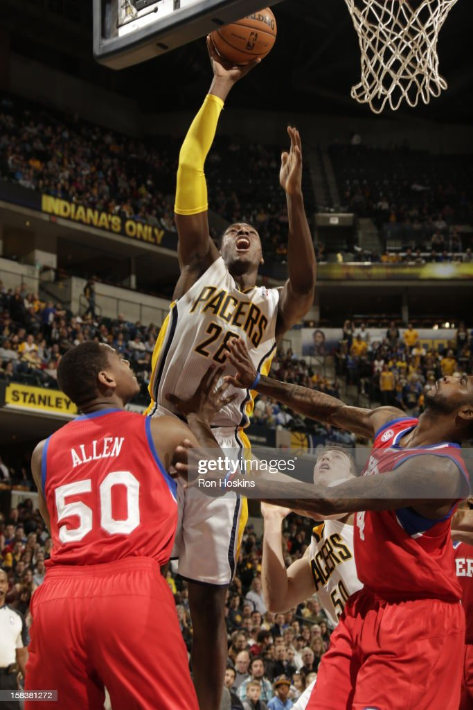 <a gi-track='captionPersonalityLinkClicked' href=/galleries/search?phrase=Ian+Mahinmi&family=editorial&specificpeople=740196 ng-click='$event.stopPropagation()'>Ian Mahinmi</a> #28 of the Indiana Pacers shoots the ball against <a gi-track='captionPersonalityLinkClicked' href=/galleries/search?phrase=Lavoy+Allen&family=editorial&specificpeople=4628334 ng-click='$event.stopPropagation()'>Lavoy Allen</a> #50 and <a gi-track='captionPersonalityLinkClicked' href=/galleries/search?phrase=Dorell+Wright&family=editorial&specificpeople=211344 ng-click='$event.stopPropagation()'>Dorell Wright</a> #4 of the Philadelphia 76ers on December 14, 2012 at Bankers Life Fieldhouse in Indianapolis, Indiana.