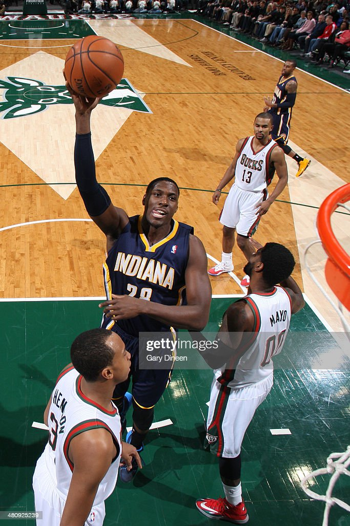 <a gi-track='captionPersonalityLinkClicked' href=/galleries/search?phrase=Ian+Mahinmi&family=editorial&specificpeople=740196 ng-click='$event.stopPropagation()'>Ian Mahinmi</a> #28 of the Indiana Pacers shoots the ball against the Milwaukee Bucks on February 22, 2014 at the BMO Harris Bradley Center in Milwaukee, Wisconsin.
