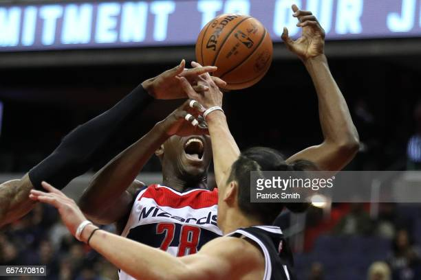 Ian Mahinmi of the Washington Wizards is fouled by Jeremy Lin of the Brooklyn Nets during the first half at Verizon Center on March 24 2017 in...