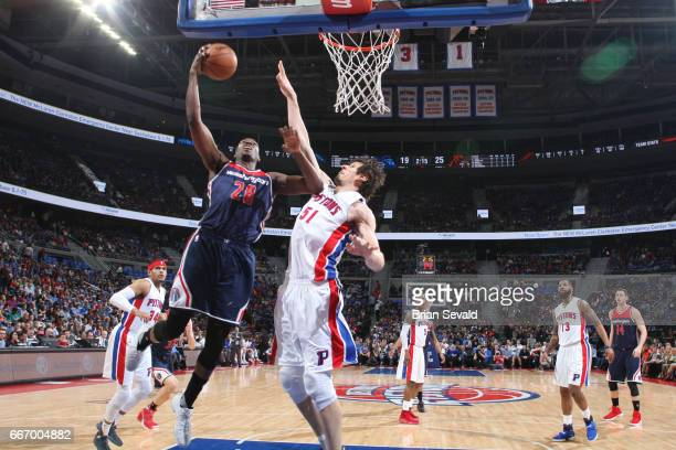 Ian Mahinmi of the Washington Wizards shoots the ball against the Detroit Pistons on April 10 2017 at The Palace of Auburn Hills in Auburn Hills...